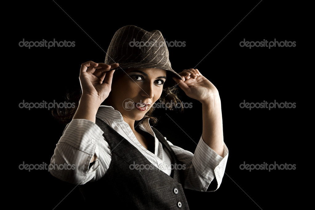 Young woman portrait with hat on a black background  Stock Photo #5064817