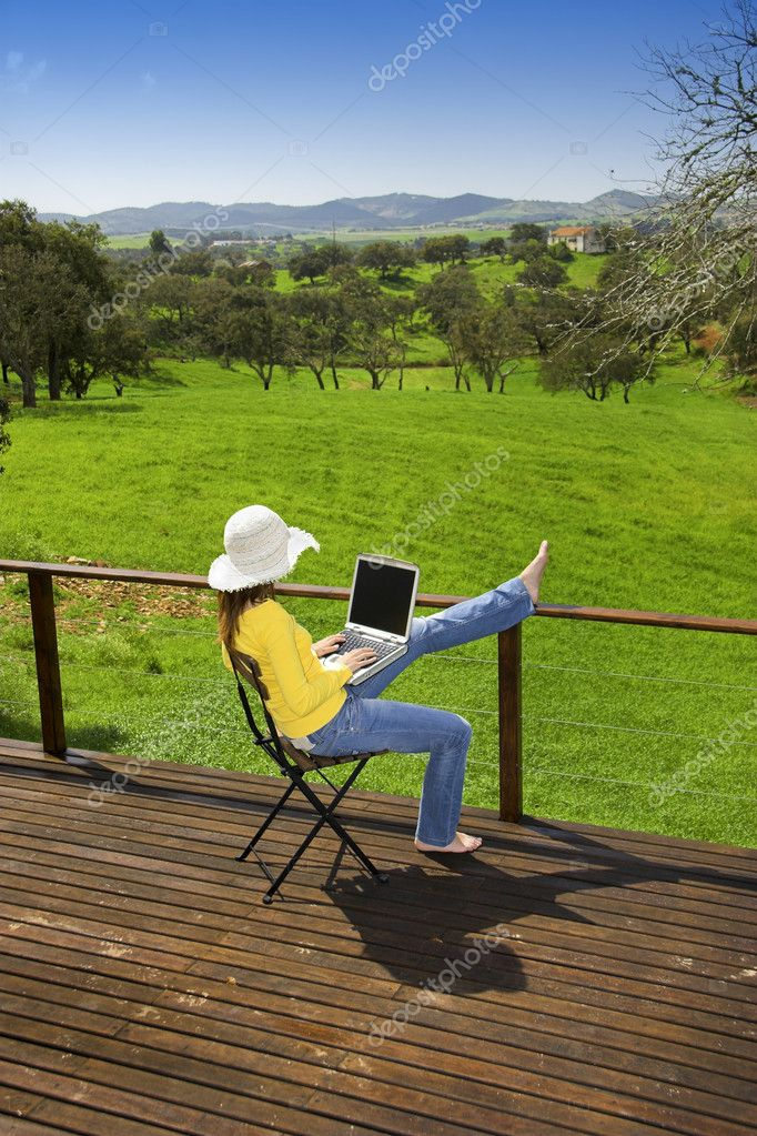 Woman enjoying a beautiful day with a laptop on her home-field  Photo #5064906