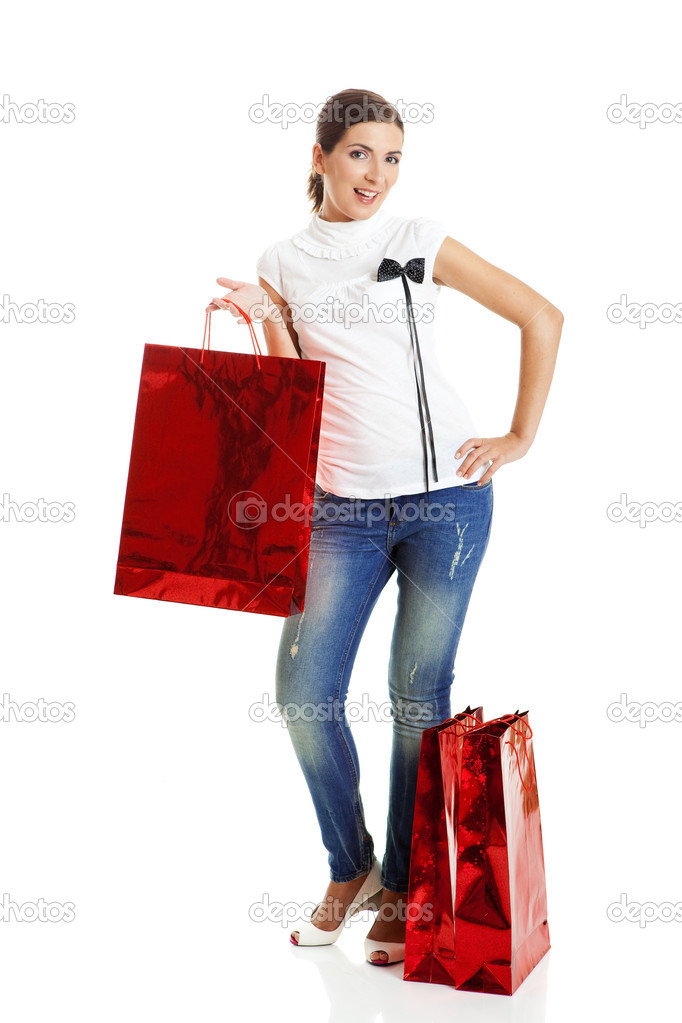 Beautiful young woman with red shopping bags. Consumerism Concept — Stock Photo #5065392