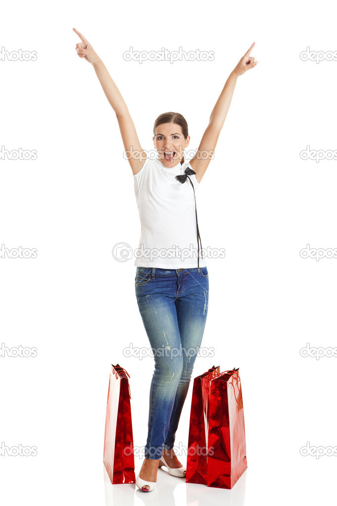 Beautiful young woman with red shopping bags. Consumerism Concept  Stock Photo #5065396