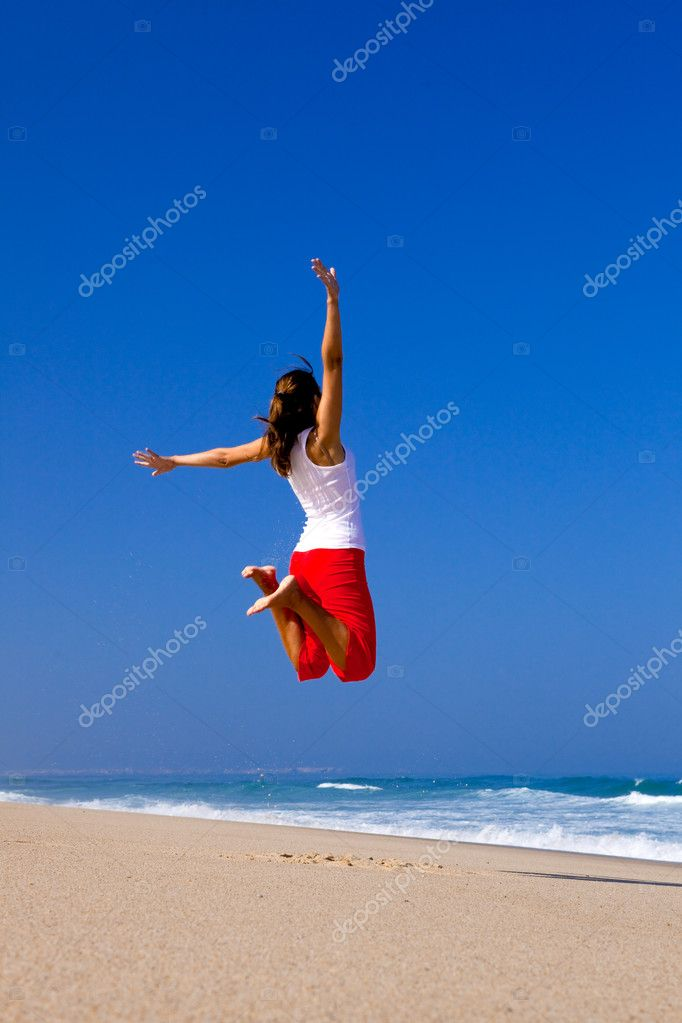 Beautiful young woman jumping on  the beach — Stock Photo #5067820