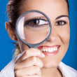 Looking through a magnifying Glass - Stock Photo