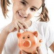Stock Photo: Little girl with piggy-bank
