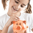 Little girl with a piggy-bank — Stock Photo #5072957