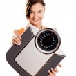 Athletic girl with a scale — Stock Photo #5073494