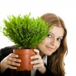 Business Woman holding a vase with a plant — Stock Photo