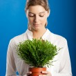 Woman with a Plant — Stock Photo