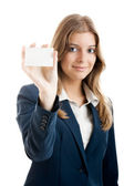 Beautiful woman holding a business card — Stock Photo
