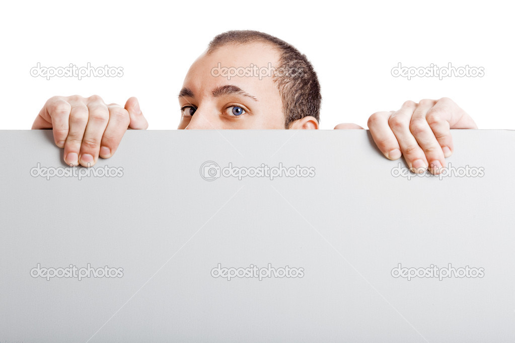 Businessman holding a blank billboard and peeking over it, isolated on white background  Photo #5070057