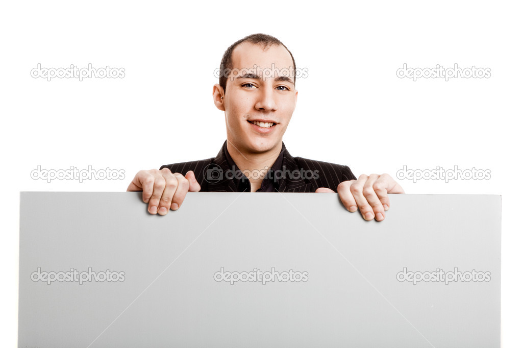 Businessman holding a blank billboard, isolated on white background — Stock Photo #5070063