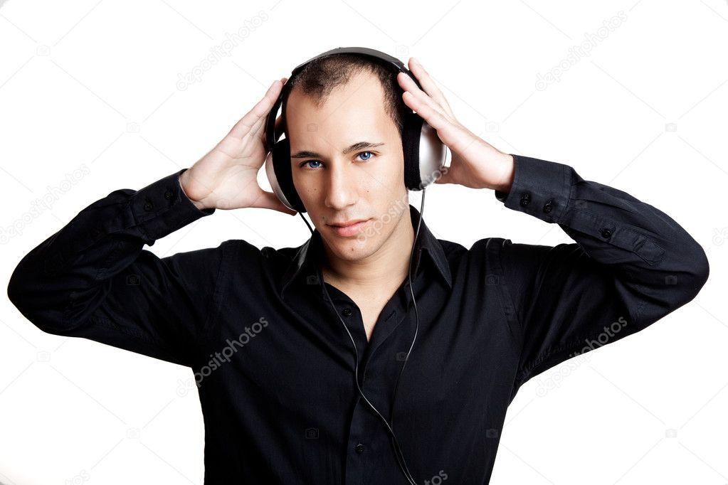Portrait of a young man listening music with headphones — Stock Photo #5070135