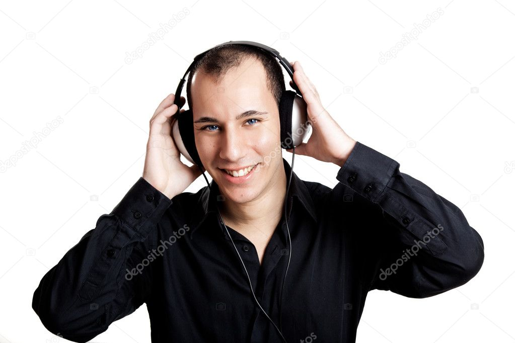 Portrait of a young man listening music with headphones  Stock Photo #5070138