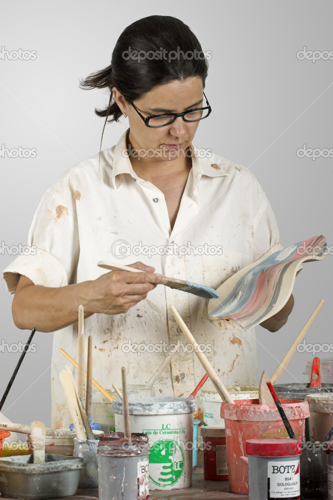 Picture of a potter painting a clay piece — Stock Photo #5071711