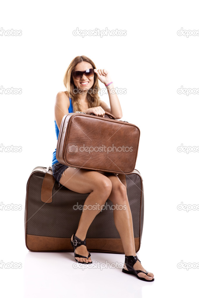 Beautiful young woman seated and waiting with two old leather suitcases, isolated on white — Stock Photo #5071991
