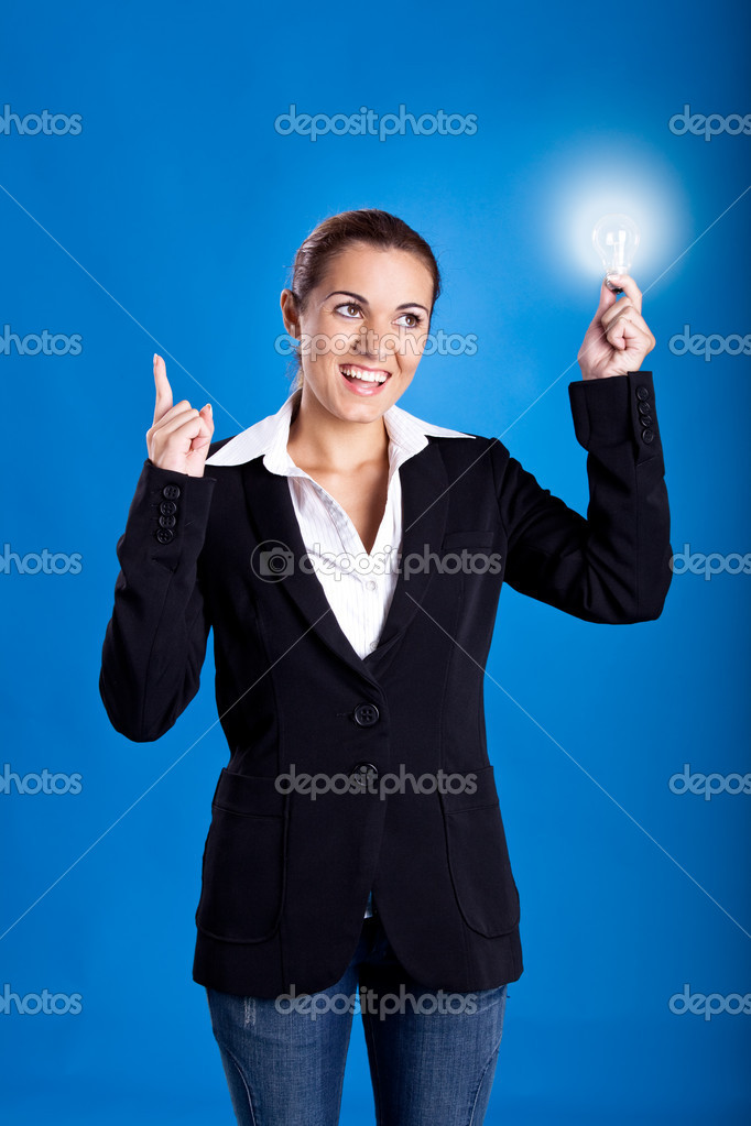 Portrait of a beautiful and young businesswoman holding a lightbulb  Stock Photo #5072425