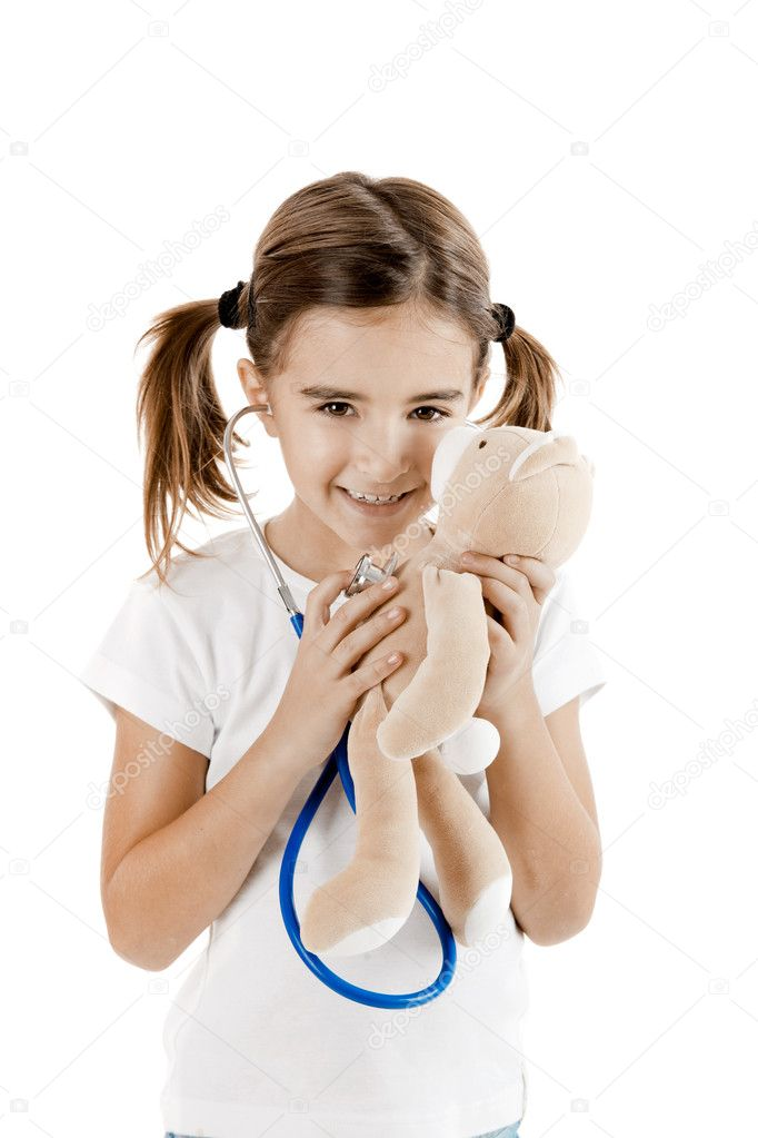 Beautiful little girl pretending to be a nurse and auscultate her teddy-bear — Stock Photo #5072943