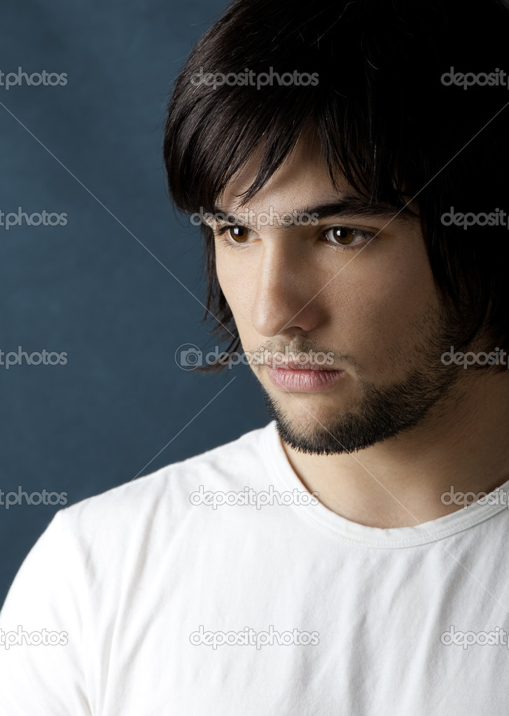 Picture of Good looking  young man portrait over a blue background — Stock Photo #5074339