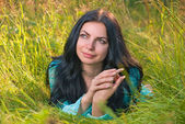 Young woman in grass — Stock Photo