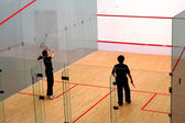 Playing squash — Stock Photo