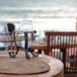 Table set at beach — Stock Photo