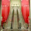 Escalators in airport - Stock Photo