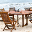 Table set at beach - Stock Photo