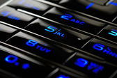 Blue mobile keypad under dark — Stock Photo