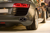 Back of supercar at show — Stock Photo