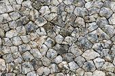 Irregular stone wall — Stock Photo