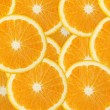 Juicy orange fruit background - Stock Photo