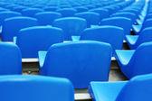 Empty blue plastic stadium seats — Стоковое фото