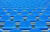 Empty blue plastic stadium seats — Stock Photo