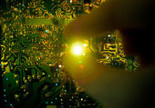 Working on a shiny electrical circuit board. — Stock Photo