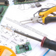 Electronic circuit and tools — Stock Photo