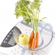 Carrots, apple and measuring objects — Stock Photo #3898829