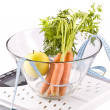 Carrots, apple and measuring objects — Stock Photo #3898833