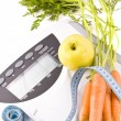 Carrots, apple and measuring objects — Stock Photo #3898837