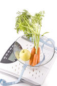 Carrots, apple and measuring objects — 图库照片