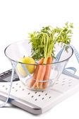 Carrots, apple and measuring objects — Stock Photo
