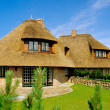 House with thatched roof (Sylt) - Stock Photo