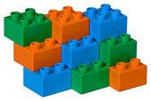 Blue, green and orange plastic toy brick — Stock Photo