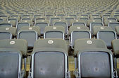 Grey stadium seats — Stock Photo
