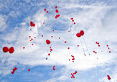 Red balloons flying to the sky — Stock Photo