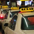 Taxis waiting at the airport - Stock Photo