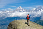 Hiker in the swiss alps — Stock Photo