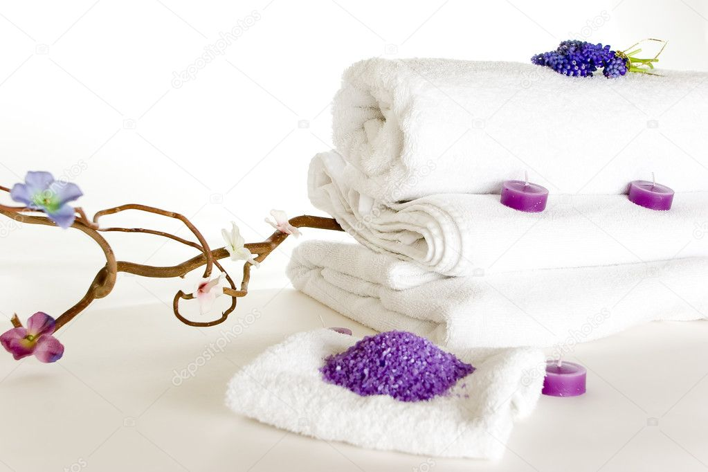 The spa set of white towels, lavender candles, lavender sea salt, flower and branch — Stock Photo #3086829