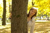 Woman in an autumn park — Stock Photo