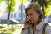 Female calling by phone — Stock Photo