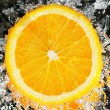 Stock Photo: Fresh orange in streaming water
