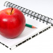Notebook and apple — Stock Photo